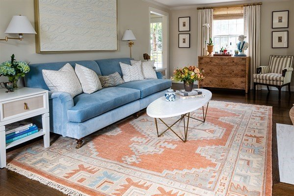 Contrast your living room colors using a combination of rugs and furniture