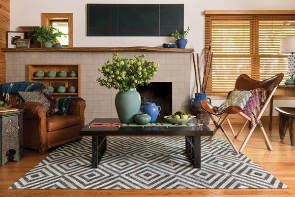 Add some flavor with geometrics in your rugs to your living room.