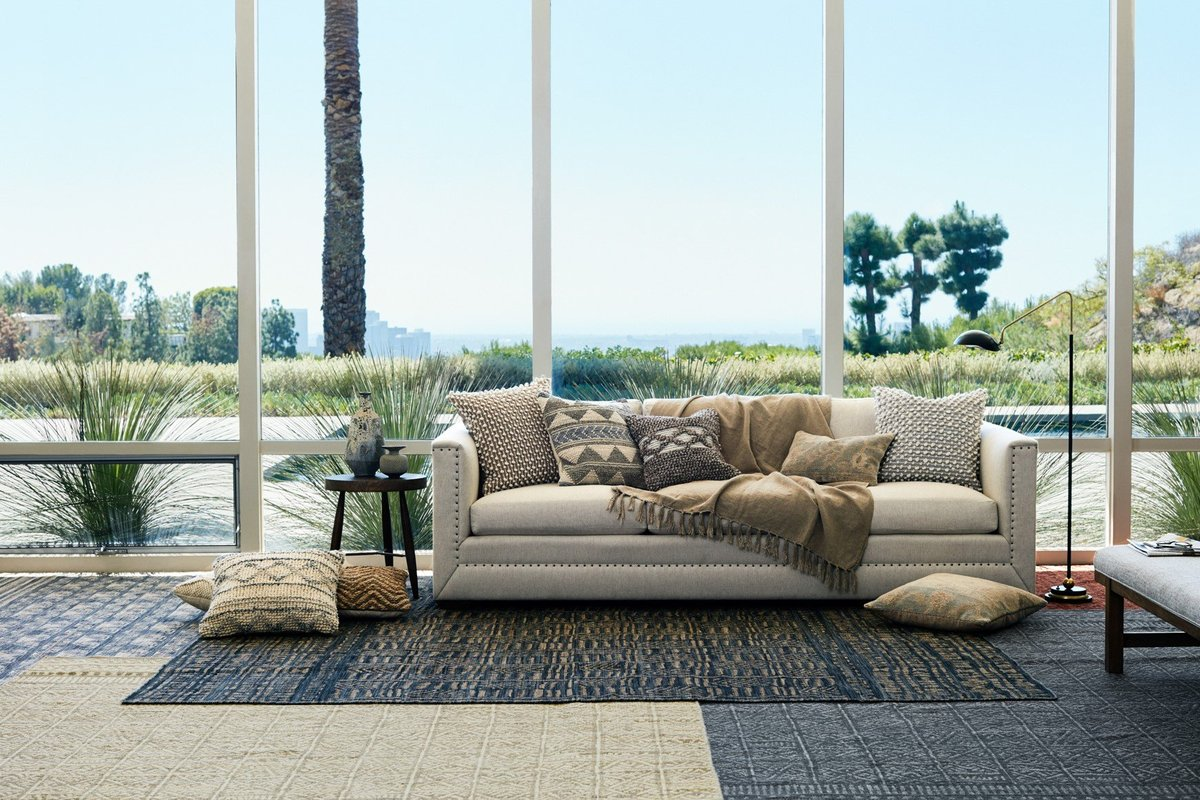 Use your living room rug to layer your look