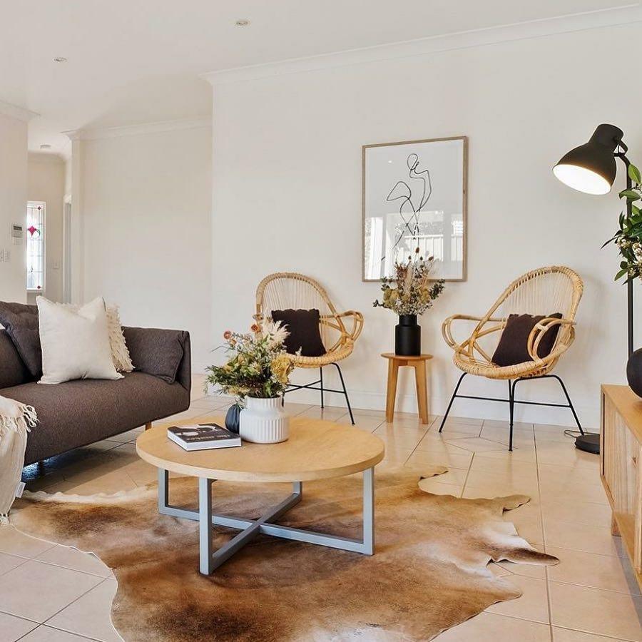 Tan cowhide rug in living room